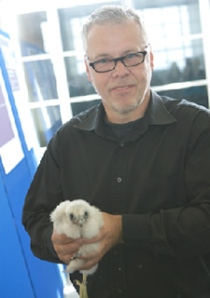 Nigel Smith holding one of the 2011 falcon babies